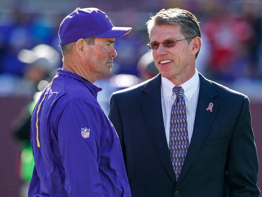 Oct 18, 2015; Minneapolis, MN, USA; Minnesota Vikings head coach Mike Zimmer (L) speaks with general manager Rick Spielman (R) prior to their game against the Kansas City Chiefs at TCF Bank Stadium.