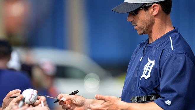Detroit Tigers manager Brad Ausmus signs autographs at Joker Marchant Stadium.