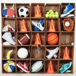 Cardboard box lockers filled with sports equipment