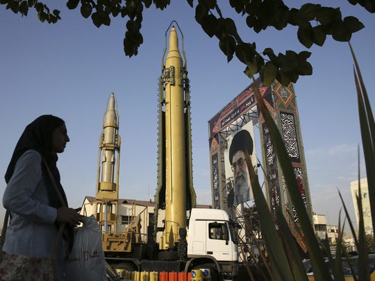 In this Sept. 24 photo, a Ghadr-H missile, center, a solid-fuel surface-to-surface Sejjil missile and a portrait of the Supreme Leader Ayatollah Ali Khamenei are displayed at Baharestan Square in Tehran, Iran, for the annual Defense Week which marks the 37th anniversary of the 1980s Iran-Iraq war.