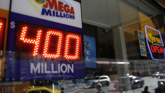 A sign displaying a Mega Millions jackpot.