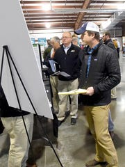 People in attendance explore the Atlantic Coast Pipeline construction expo held at Augusta Expo in Fishersville on Thursday, Dec. 8, 2016.