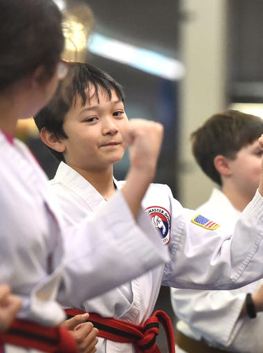Ten-year-old B.C. Sommerfield, a red belt with black stripe in Tae Kwon Do, practices an inside block during a class at the Dong's Martial Arts studio in Staunton on Jan. 16, 2017. Sommerfield has since advanced to the rank of BoDan (aka. pre-black belt).