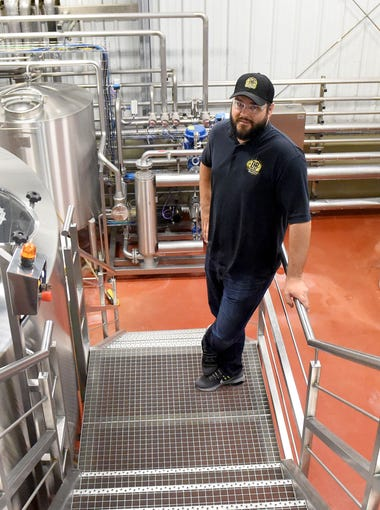 Production brewmaster Joshua French is photographed inside the brewhouse at the Devil's Backbone Outpost Brewery in Lexington on April 18, 2017.