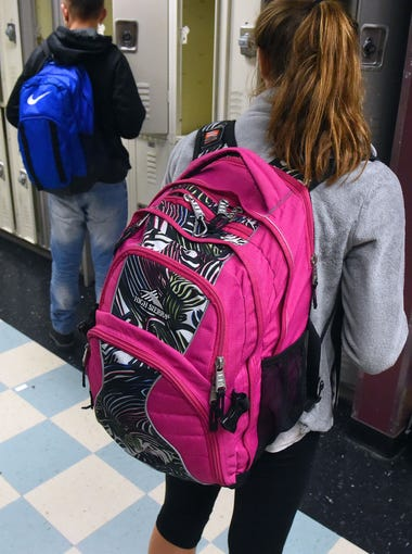 Students in a hallway at Kate Collins Middle School in Waynesboro.