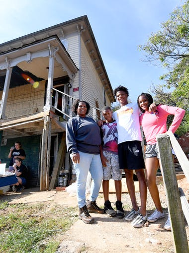 Very Brown (left) stands with son son Ajablea Caul, 11; Kyiam Brown, 15; and daughter Emysja Caul, 13. They are a partner family working with Staunton-Augusta-Waynesboro Habitat for Humanity to renovate a house on Richardson Street that will one day be their home. (Not pictured is son Azabdijah Brown, 17.)