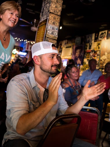 John Ray Watts, center, of Nashville, claps along to music during a rally at Bobby's Idle Hour in Nashville, Tenn., Tuesday, July 24, 2018. The historic bar and neighboring buildings are at risk of demolition to make way for a new music industry office building.