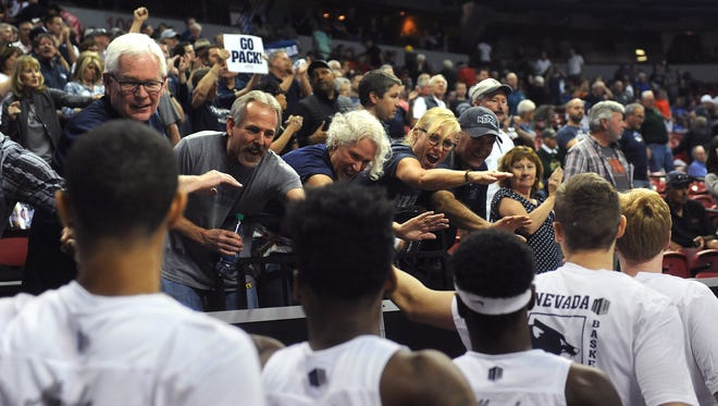 Wolf Pack supporters greet the players after the team's win over Utah State on Thursday.