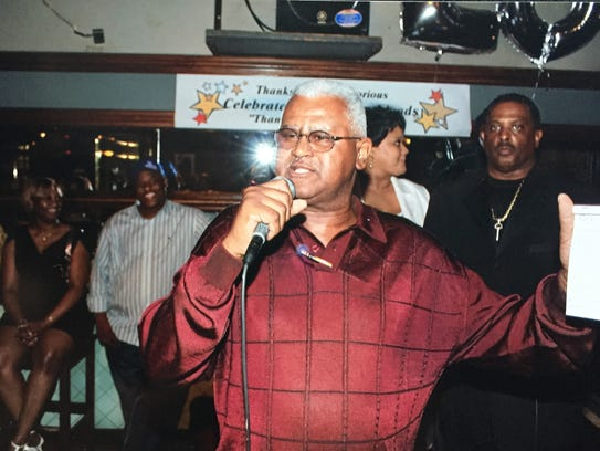 Flood's owner Michael Byrd at the bar and restaurant's