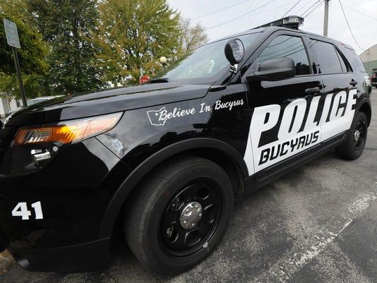 BUC 1013 Police cruisers.jpg