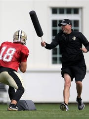 New Orleans Saints quarterback Garrett Grayson, left,