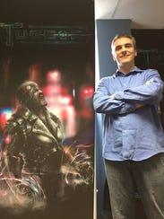 Scott Reshke, CEO of Strength in Numbers Studios, stands