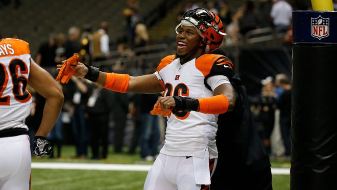 Cincinnati Bengals defensive end Carlos Dunlap (96) gets his groove on during  pre game against the New Orleans Saints at the Superdome in New Orleans.  The Enquirer/Jeff Swinger