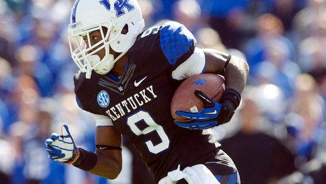 UK wide receiver Demarco Robinson runs after a catch during a 2012 game against Mississippi State Bulldogs at Commonwealth Stadium.