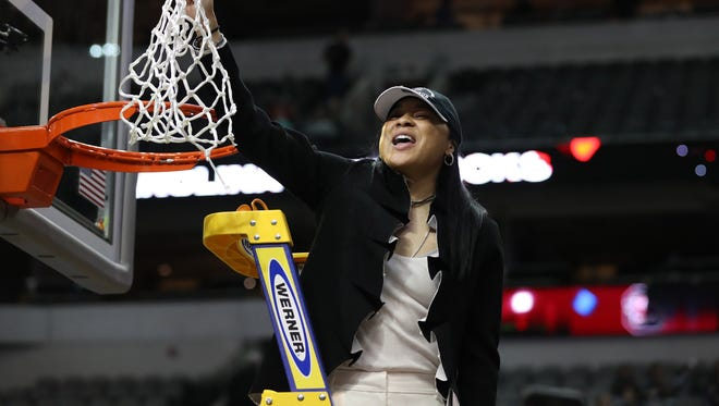 Dawn Staley celebrates as she cuts down the net after South Carolina defeated Mississippi State in the 2017 NCAA women's national title game.