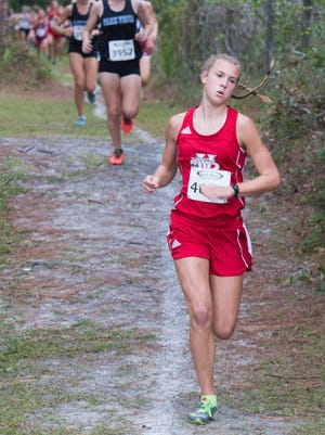 """Grace Gumpel, 16, a junior at Vero Beach High School makes her way along a trail behind South Fork High School during the Region 3-4A cross-country meet on Saturday, October 29, 2016 in Tropical Farms. Gumpel finished 10th overall.  The Vero Beach girls team finished first and will head to Tallahassee on Nov. 5 for the state finals. ÒThey were seeded third or fourth earlier in the season but they knew they wanted that first place title,"""" said Kelli Stewart (not pictured), Vero Beach High School's cross-country coach. """"It was very close. At the end of the race they didnÕt think were going to get it.  They were very surprised."""" The top six teams and top 15 runners in each regional advance to the Florida High School Cross-Country State Championships.To see more photos, go to TCPalm.com"""