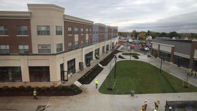File photo: Work proceeds on the College Town development project at Mt. Hope and Elmwood avenues.