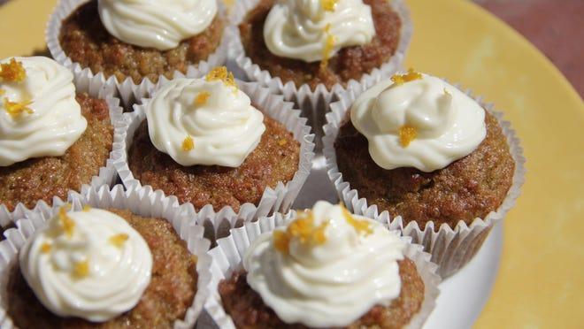 Mini quinoa carrot cakes are made in mini cupcake pans.