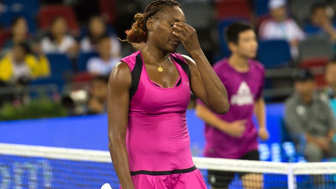 Venus Williams of the United States reacts after losing the match to Svetlana Kuznetsova of Russia in the WTA Wuhan Open in Wuhan in central China's Hubei province, Wednesday, Sept. 28, 2016. Kuznetsova defeated Williams in the match. (Chinatopix via AP)