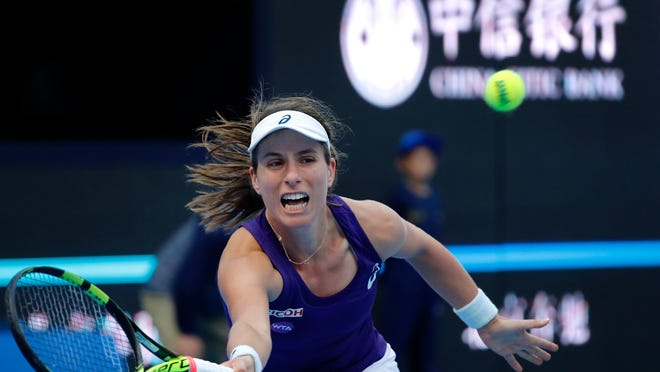 Johanna Konta of Britain hits a return shot against Madison Keys of the United States during the women's singles semifinals of the China Open tennis tournament at the Diamond Court in Beijing, Saturday, Oct. 8, 2016. (AP Photo/Andy Wong)