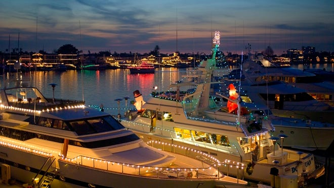 """""""Seas"""" the holidays during the Annual Newport Beach Christmas Boat Parade, featuring hundreds of brightly decorated vessels illuminating the harbor waterway."""