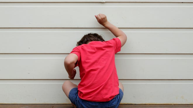 A child in trouble and throwing a tantrum.