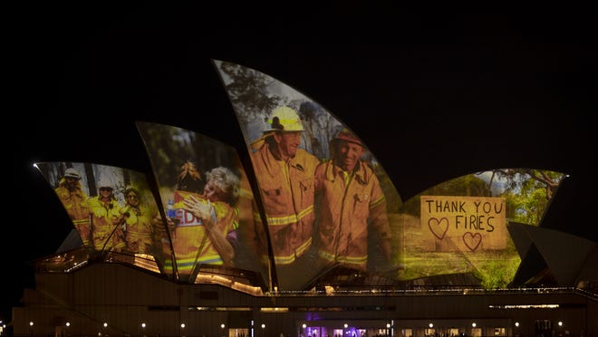 Images taken during the ongoing bushfire crisis are projected on the sails of the Sydney Opera House on January 11, 2020 in Sydney, Australia. The projections are to show support for communities affected by bushfires around Australia and the firefighters who have been defending them.