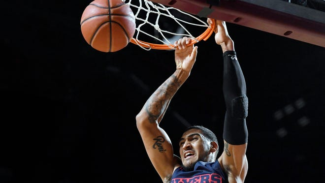 Dayton's Obi Toppin dunks the ball in the first half of an NCAA college basketball game against Massachusetts, Saturday, Feb. 15, 2020, in Amherst, Mass. (AP Photo/Jessica Hill)