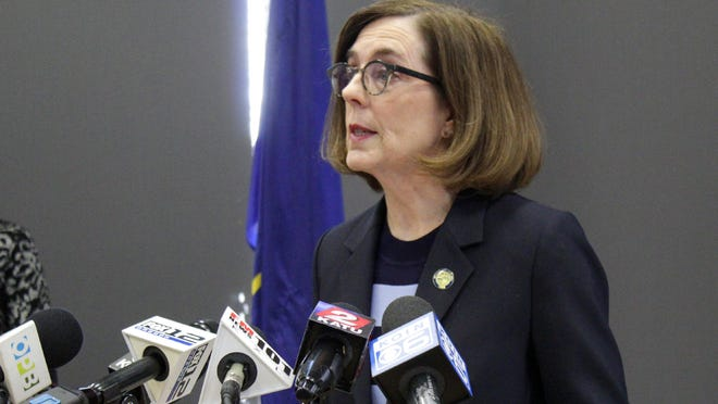 Gov. Kate Brown speaks at a news conference to announce a four-week ban on eat-in dining at bars and restaurants throughout the state in Portland to slow the spread of the new coronavirus.