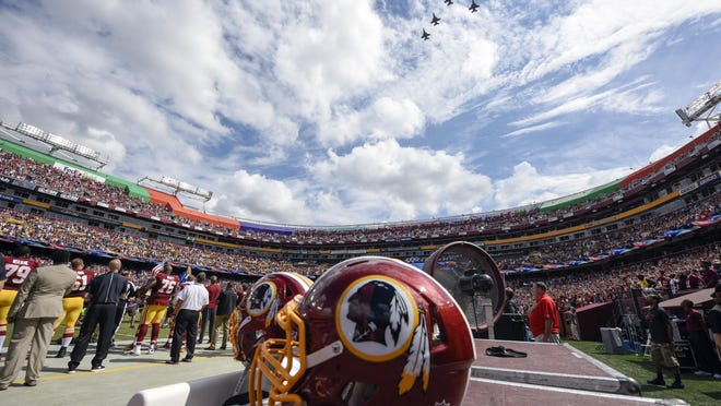 F-26 fighter jets from the DC Air National Guard fly over FedEx Field before an NFL football game between the Washington Redskins and the Dallas Cowboys in Landover, Md., on Sept. 18, 2016.