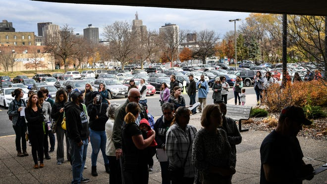 People line up to cast their ballots early on Nov. 7, 2016, at the Plato Building in St. Paul, Minn.  Across the country, elections officials are marshaling data to reduce wait times at polling places. But white voters are benefiting far more from such innovations than Latino or black voters are.
