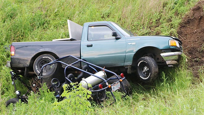 Scott Livingston, 52, of Mansfield drove this 996 Ford Ranger towing a dune buggy off Ohio 95 and struck this embankment on Thursday evening.