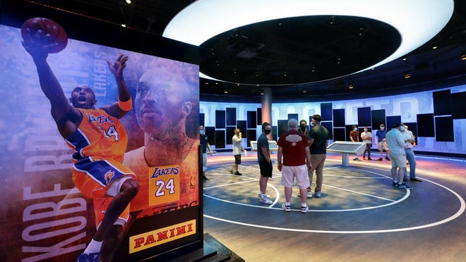 An exhibit at the Naismith Memorial Basketball Hall of Fame, in Springfield, Mass., shown Tuesday, June 23, 2020, features images of Los Angeles Lakers' Kobe Bryant. The museum is scheduled to reopen in the beginning of July 2020 after a renovation.