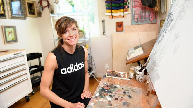 Artist Erin Mulligan works in her studio.