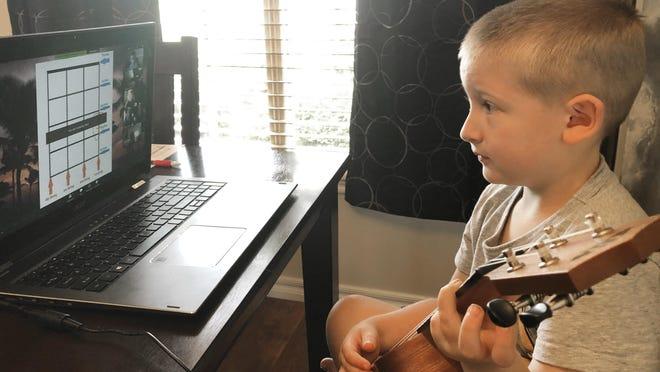 Christina Rothermel-Branham's son, James, does school work at their Tahlequah, Okla., home.