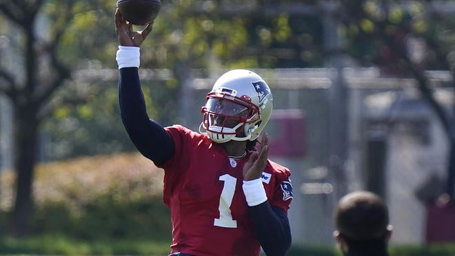 New England Patriots quarterback Cam Newton (1) passes the ball during an NFL football training camp practice, Sunday, Aug. 23, 2020, in Foxborough, Mass.
