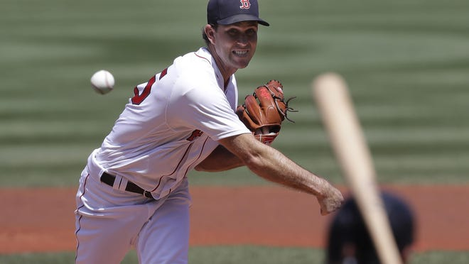 Boston's Ryan Weber delivers against the Baltimore Orioles during the first inning of Sunday's game at Fenway Park.