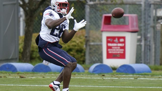 New England Patriots running back Sony Michel tracks the the ball during an NFL football training camp practice, Thursday, Aug. 27, 2020, in Foxborough, Mass.