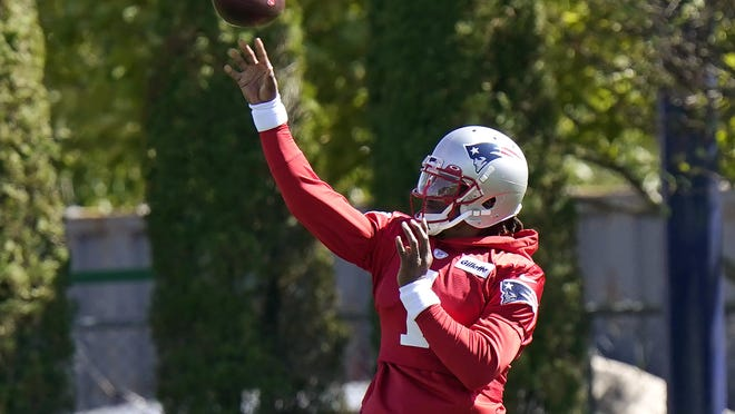 New England Patriots quarterback Cam Newton (1) passes the ball during an NFL football training camp practice, Sunday, Aug. 30, 2020, in Foxborough, Mass.