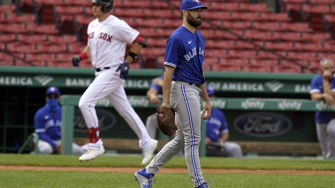 The Red Sox' Bobby Dalbec rounds third base after hitting a home run off the Blue Jays' Robbie Ray in the fourth inning on Sunday. Boston has lost six of their last eight games.