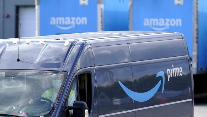 An Amazon Prime logo appears on the side of a delivery van as it departs an Amazon Warehouse location, Thursday, Oct. 1, 2020, in Dedham, Mass. Halloween is still weeks away, but retailers are hoping you'll start your holiday shopping now. The big push is coming from Amazon, which is holding its annual Prime Day sales event Tuesday, Oct. 13 and Wednesday, Oct. 14.