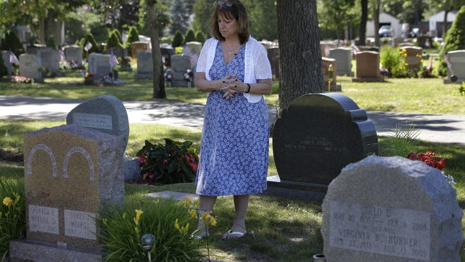 Cheryl Juaire, shown visiting her son's grave in Chelmsford in 2018, founded Team Sharing Inc. in 2015 to help parents who lost their children to substance abuse. The organization is now a nonprofit with chapters in 21 states.