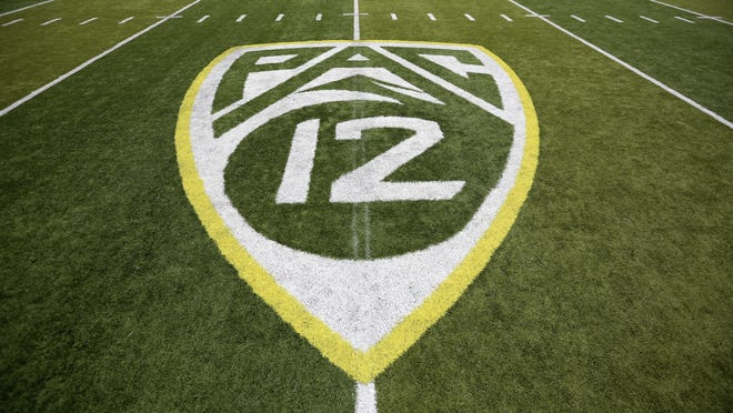 FILE- In this Oct. 10, 2015, file photo, a PAC-12 logo is displayed on the field before an NCAA college football game between Washington State and Oregon in Eugene, Ore. The Pac-12 university presidents and chancellors will meet Friday, Sept. 17, 2020, and be presented options for staging a fall football season, but Commissioner Larry Scott says a vote by the the CEO Group is not expected.