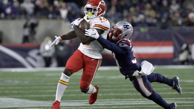New England Patriots defensive back Jonathan Jones, right, tackles Kansas City Chiefs wide receiver Tyreek Hill during a game Dec. 8, 2019, in Foxborough.