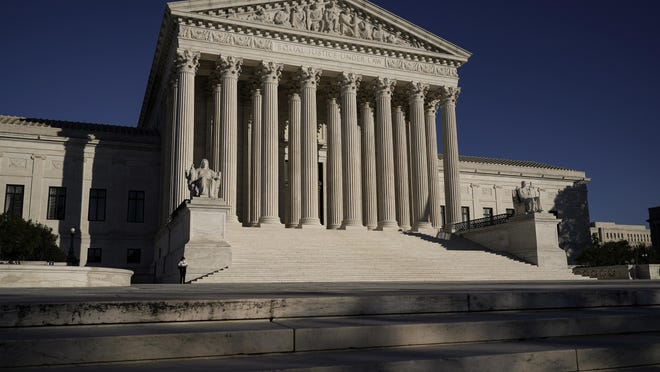 The Supreme Court is seen in Washington, Wednesday, Nov. 4, 2020. The Trump campaign is seeking to intervene in a Pennsylvania case at the Supreme Court that deals with whether ballots received up to three days after the election can be counted. (AP Photo/J. Scott Applewhite)