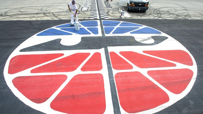 Robert Fredrickson, front, and Bill Schlage, back, paint the logos at the start/finish line at Bristol Motor Speedway in Bristol, Tenn., Tuesday morning, Aug. 13, 2019. Bristol hosts NASCAR Cup Series, Xfinity and Truck Series races this week.
