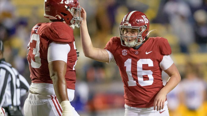 Alabama's Will Reichard (16) celebrates his field goal with offensive lineman Evan Neal (73) during the first half of the team's NCAA college football game against LSU in Baton Rouge, La., Saturday, Dec. 5, 2020. (AP Photo/Matthew Hinton)