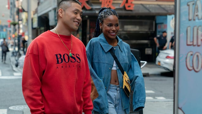 """Taylor Takahashi, left, as Alfred (Boogie) Chin and Taylour Paige as Eleanor in a scene from """"Boogie."""""""