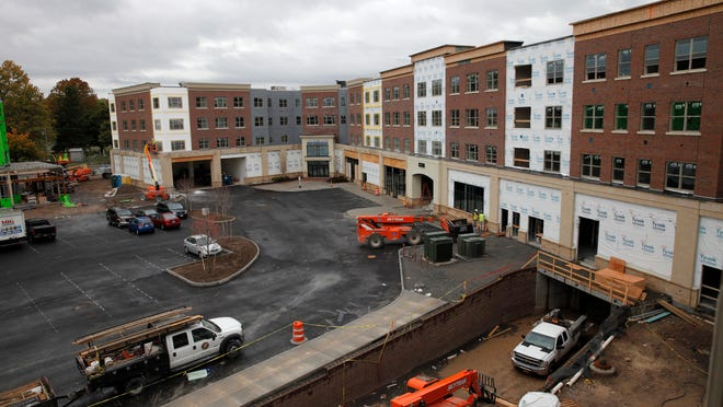 Residential space in the three floors above retail space is shaping up at College Town along Mt. Hope and Elmwood avenues. This view is from the back side.