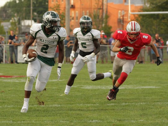 Madison's Tyrell Ajian runs against the Shelby defense during the opening game of the season on Aug. 25.